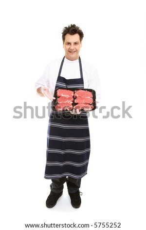 A butcher presents some boneless meat cuts. - stock photo