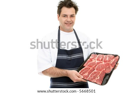 A butcher showcases a tray of beef steak. - stock photo