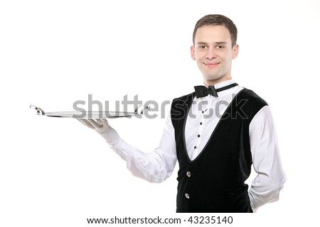 A butler holding an empty silver tray isolated on white background - stock photo