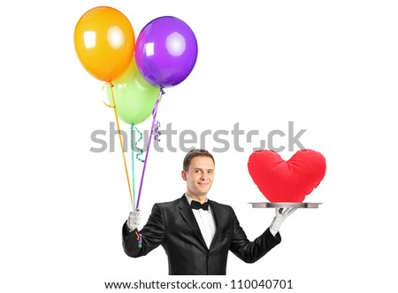 A butler holding balloons and a tray with a heart shape object isolated on white - stock photo