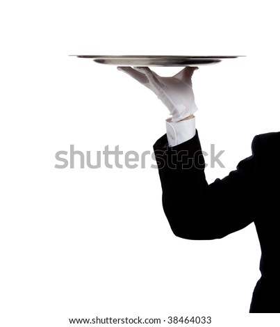 a butler's gloved hand holding a silver tray on a white background with copy space - stock photo
