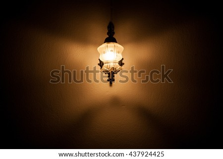 A Butterfly Wall Lamp Shines in the Dark - stock photo