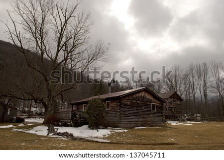 A cabin in the woods on a cloudy day
