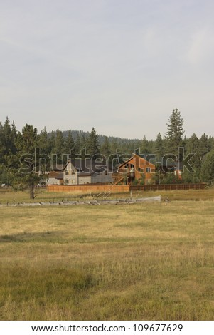 a cabin in truckee ca. in a meadow just out of down. - stock photo