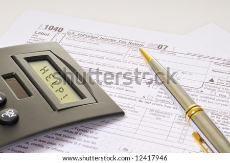 "A calculator and a pen rest on federal tax forms. The calculator screen spells, ""Help!"""