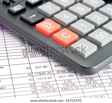 A calculator and financial statement.