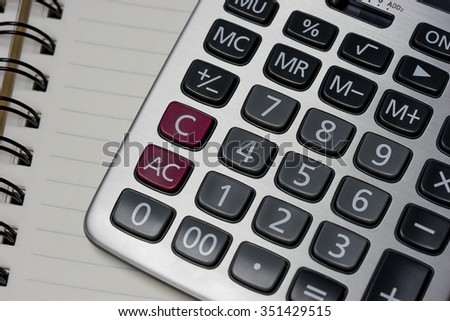 A calculator on the notebook paper