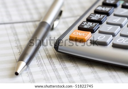 A calculator, pen, and financial statement. Selective focus. - stock photo