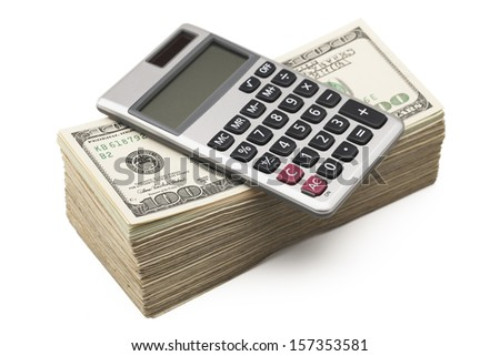A calculator sitting on a stack of hundred dollar bills isolated on white background. Clipping path included.  - stock photo