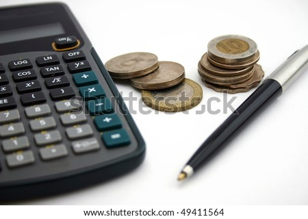 A calculator with pen and coin - stock photo