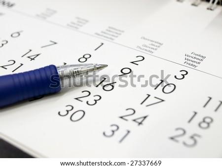 A calendar with a pen - stock photo