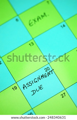 "A calendar with the word 'Exam"" and ""Assignment Due"" - stock photo"