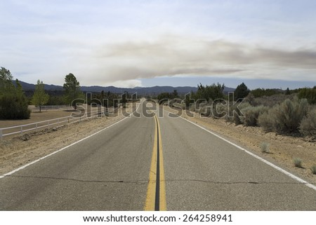 A California wildfire viewed from Lockwood Valley, Highway 33, near Ojai, California - stock photo