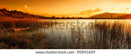 A calm evening landscape with lake and mountains - stock photo