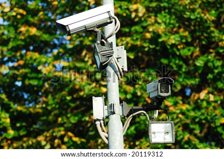 A camera used in a security system - stock photo
