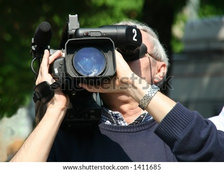 A cameraman in front of you - stock photo