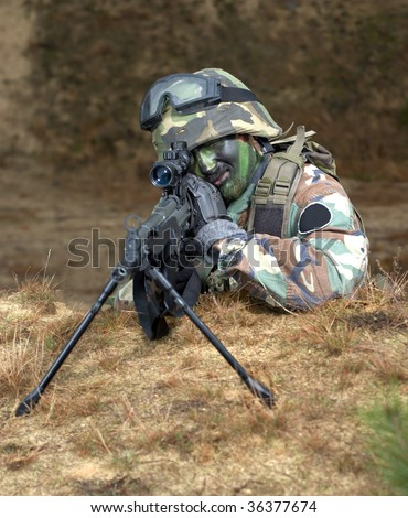 A camouflaged military sniper in a foxhole or behind an earthen barricade with a machine gun on a tripod. ASG battle. - stock photo