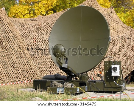 A camouflaged tactical military satellite dish - stock photo