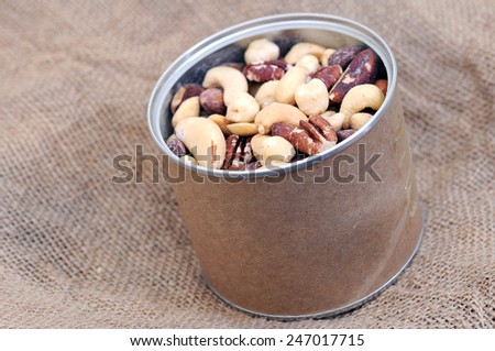 a can of nuts display in market place - stock photo
