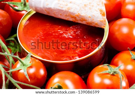 a can of whole peeled tomatoes - stock photo