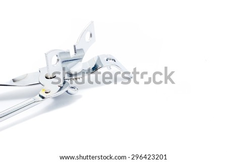 A can opener  on white background - stock photo