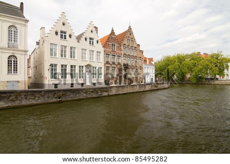 A canal and a few typical buildings in the old city of Bruges, Belgium