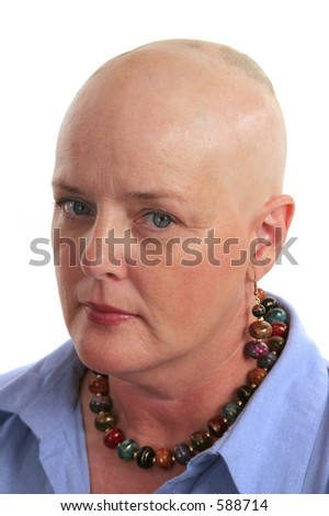 A cancer survivor undergoing chemotherapy looking scared and unhappy. - stock photo