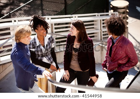A candid of a group of friends in the city - stock photo