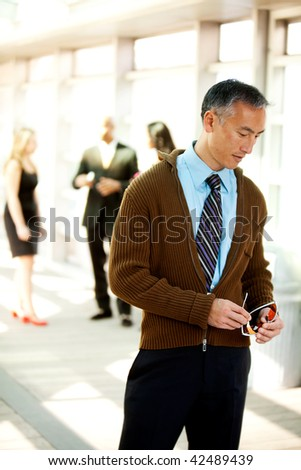 A candid portrait of a business man dressed semi-casual - stock photo