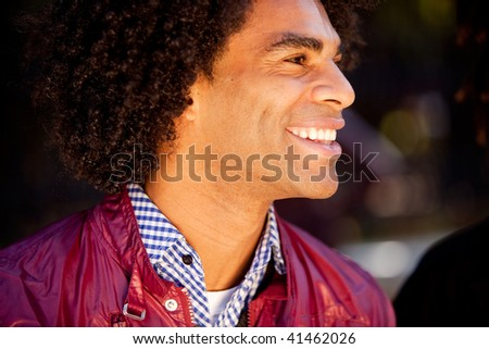 A candid portrait of a happy young man - stock photo