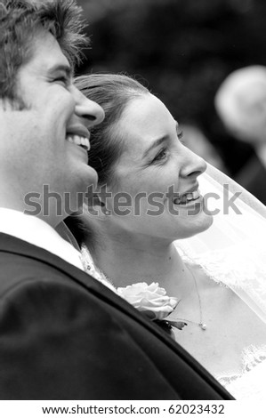A candid shot of a very happy bride and groom - stock photo