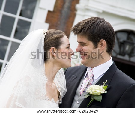 A candid shot of an intimate moment between bride and groom - stock photo