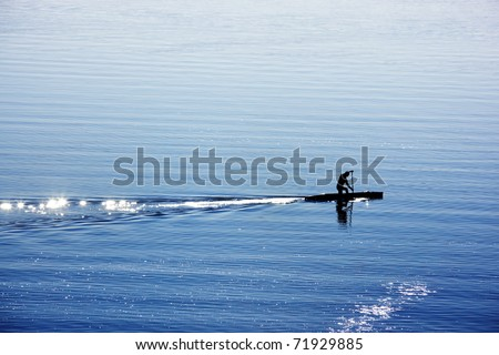 a canoe rower practicing on lake - stock photo