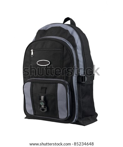 A canvas backpack with compass for student or adventure - stock photo