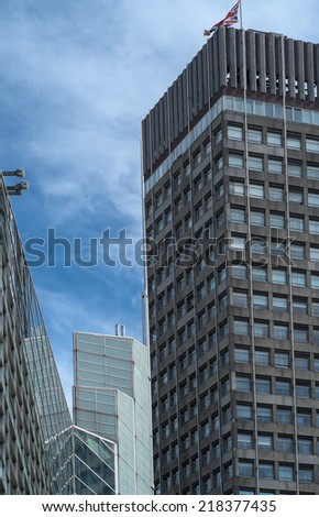 A canyon of glass and concrete near Victoria Station London - stock photo