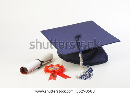 A cap and diploma isolated on white - stock photo