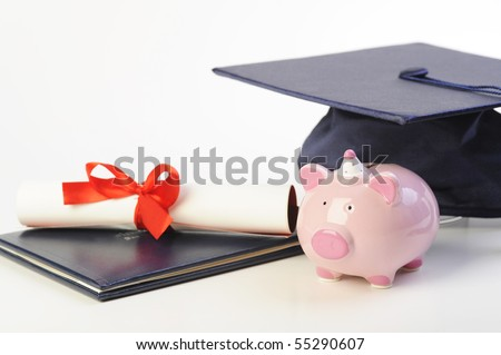 A cap, diploma and piggy bank isolated on white - stock photo