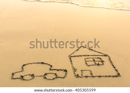 A car and a house drawn by hand on the beach sand in Sunny day. - stock photo