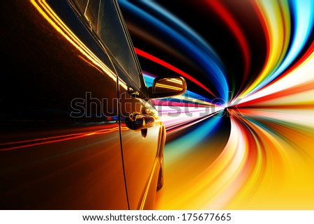 A car at high speed in the tunnel - stock photo