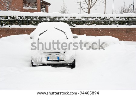 A car buried by the snow. - stock photo