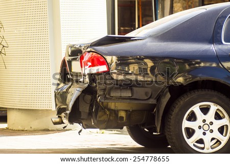 A car has a dented rear bumper after an accident - stock photo