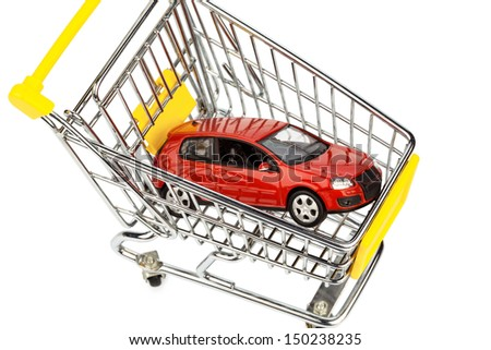 a car in the shopping cart as a symbol for car buying and leasing - stock photo