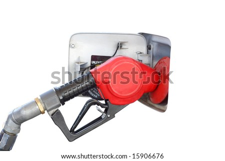 A car is refueled at a gas station. - stock photo