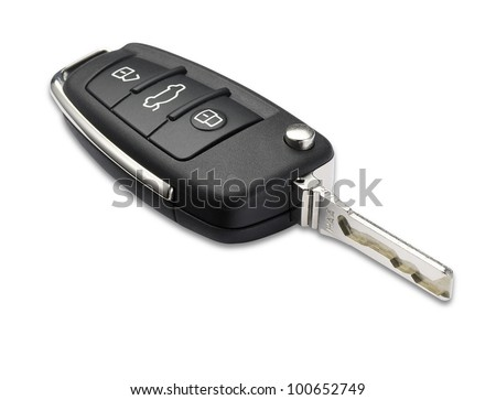 a car key with shallow depth of field on white with clipping path - stock photo
