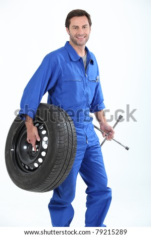 A car mechanic - stock photo