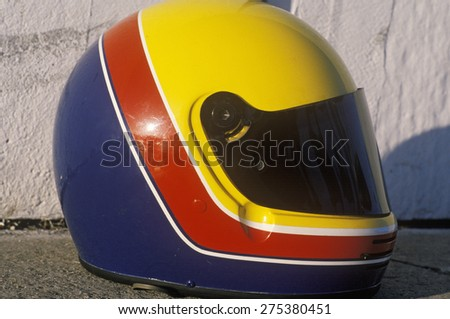 A car racer's helmet from the Toyota Grand Prix Race at the Indy Car World Series in Long Beach, CA - stock photo