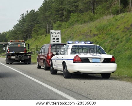 A car stopped by the police on the roadside. - stock photo