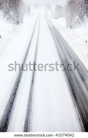 A car travelling in a snow storm - stock photo