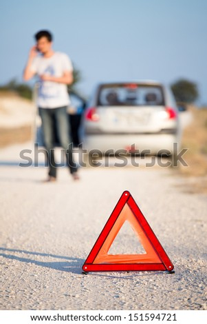 A car with a breakdown alongside the road - stock photo