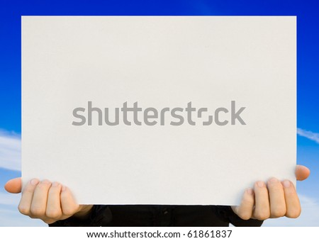 a card blank in a hand on the blue - stock photo